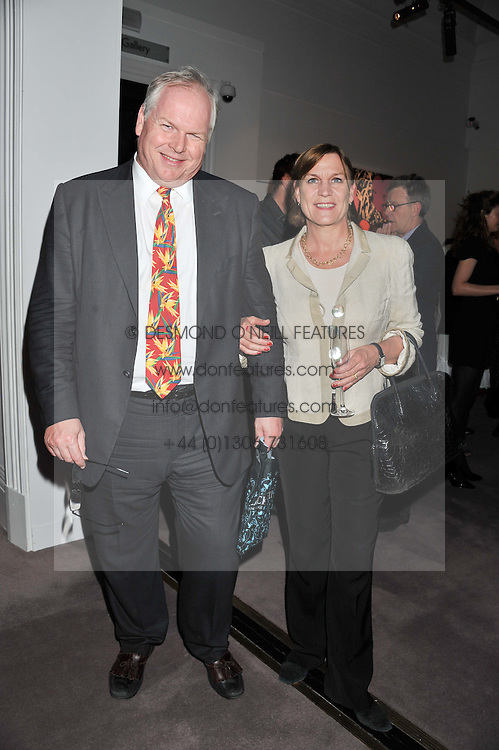 ADAM BOULTON and ANJI HUNTER at a party to celebrate the publication of Can We Still Be Friends by Alexandra Shulman held at Sotheby's, 34-35 New Bond street, London on 28th March 2012.