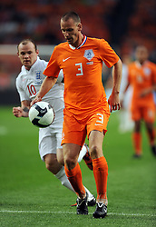 Andre Ooijer of Holland in action during the International Friendly between Netherlands and England at the Amsterdam Arena on August 12, 2009 in Amsterdam, Netherlands.