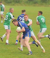 Hollymount-Carramore's Stephen Coen tries to get past Burrischoole's John Sammon during the Intermediate championship match on saturday evening last.<br /> Pic Conor McKeown