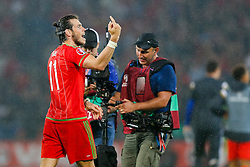 Gareth Bale of Wales (Real Madrid) celebrates after Wales win the match 1-0 to top their UEFA2016 Qualifying Group - Photo mandatory by-line: Rogan Thomson/JMP - 07966 386802 - 12/06/2015 - SPORT - FOOTBALL - Cardiff, Wales - Cardiff City Stadium - Wales v Belgium - EURO 2016 Qualifier.