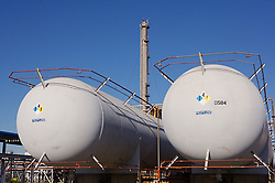 Stock photo of two large storage tanks at a chemical plant
