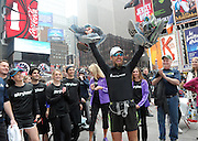 Daren Wendell, an ultra-marathon runner who completed 100 marathons in 100 days and used more than 10 pairs of sneakers, celebrates after ending his cross country journey in New York's Times Square, Friday, April 10, 2015. Wendell started his endeavor on January 1, 2015 in Santa Monica, Ca. and ran across the country to raise money for Activewater, an organization that provides safe drinking water to African communities. He accomplished this journey with a Stryker T2 Tibia Nail in his right leg, which was surgically implanted following a severe soccer injury in 2006. (Photo by Diane Bondareff/Invsion for Stryker/AP Images)