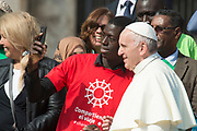 VATICAN CITY, ITALY 27 SEPT 2017: Pope Francis greets a group of migrants at the General Audience  in St. Peters Square on Sept. 27, 2017
