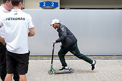 November 8, 2018 - Sao Paulo, Brazil - LEWIS HAMILTON, of Mercedes AMG Petronas, rides his scooter during the preparation day for the Formula One Grand Prix of Brazil 2018 at Interlagos circuit, in Sao Paulo. The grand prix will be celebrated next Sunday, November 11. (Credit Image: © Paulo LopesZUMA Wire)