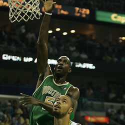 Kevin Garnett #5 of the Boston Celtics shoots over New Orleans Hornets center Tyson Chandler #6  in the first quarter of their NBA game on March 22, 2008 at the New Orleans Arena in New Orleans, Louisiana. The New Orleans Hornets defeated the Boston Celtics 113-106.
