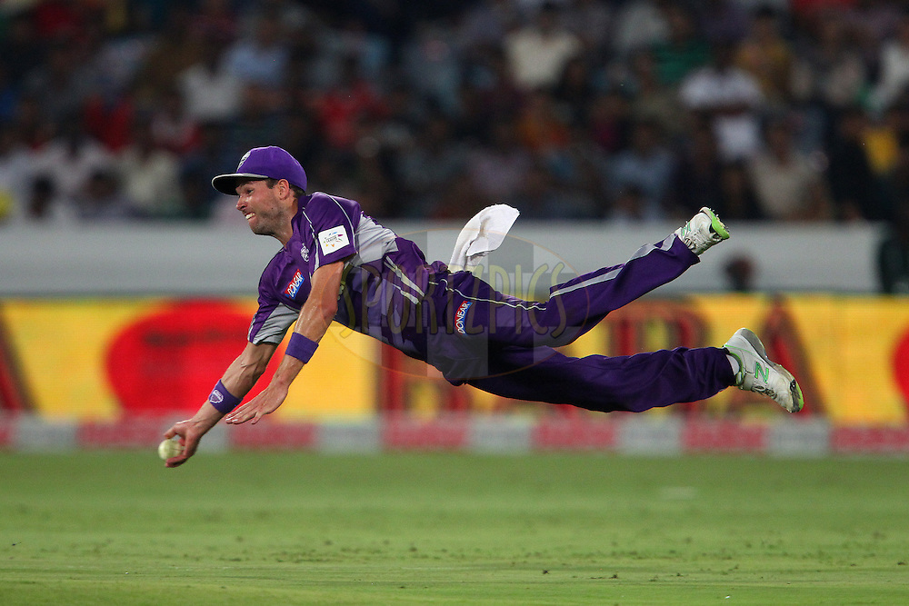 Ben LAUGHLIN of the Hobart Hurricanes throws the ball in to try and run out Yusuf PATHAN of the Kolkata Knight Riders  during the first semi final match of the Oppo Champions League Twenty20 between the Kolkata Knight Riders and the Hobart Hurricanes held at the Rajiv Gandhi Cricket Stadium, Hyderabad, India on the 2nd October 2014<br /> <br /> Photo by:  Ron Gaunt / Sportzpics/ CLT20<br /> <br /> <br /> Image use is subject to the terms and conditions as laid out by the BCCI/ CLT20.  The terms and conditions can be downloaded here:<br /> <br /> http://sportzpics.photoshelter.com/gallery/CLT20-Image-Terms-and-Conditions-2014/G0000IfNJn535VPU/C0000QhhKadWcjYs