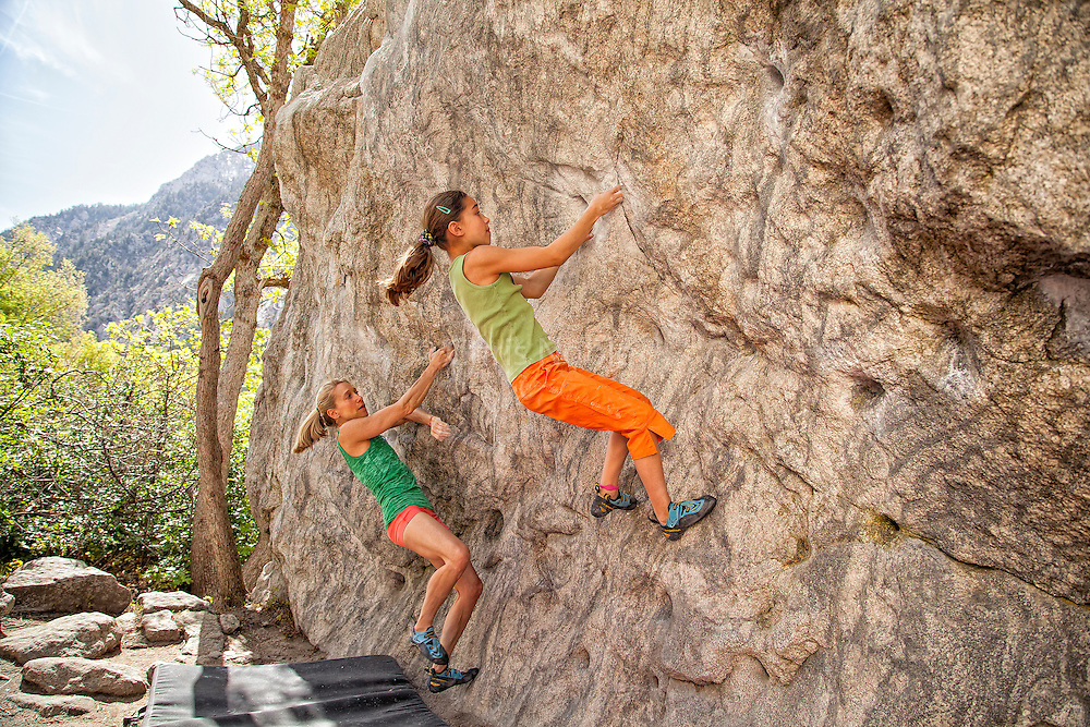 Champion climber Robyn Erbesfield-Raboutou and her daughter Brooke Raboutou (age 11) bouldering in Little Cottonwood Canyon, Utah.