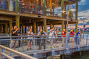 Photographers at Kemah Boardwalk, an entertainment complex in Kemah, Texas, featuring an amusement park, hotel, dining, and music.