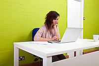 Young woman working at her desk