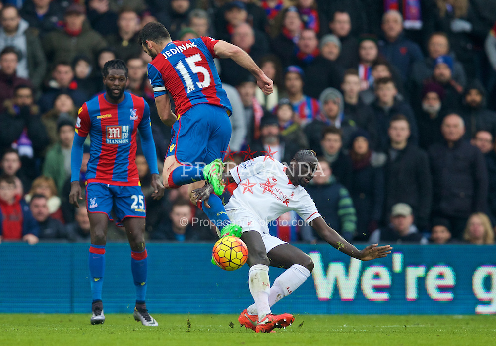 LONDON, ENGLAND - Sunday, March 6, 2016: Liverpool's Mamadou Sakho tackles Crystal Palace's captain Mile Jedinak during the Premier League match at Selhurst Park. (Pic by David Rawcliffe/Propaganda)