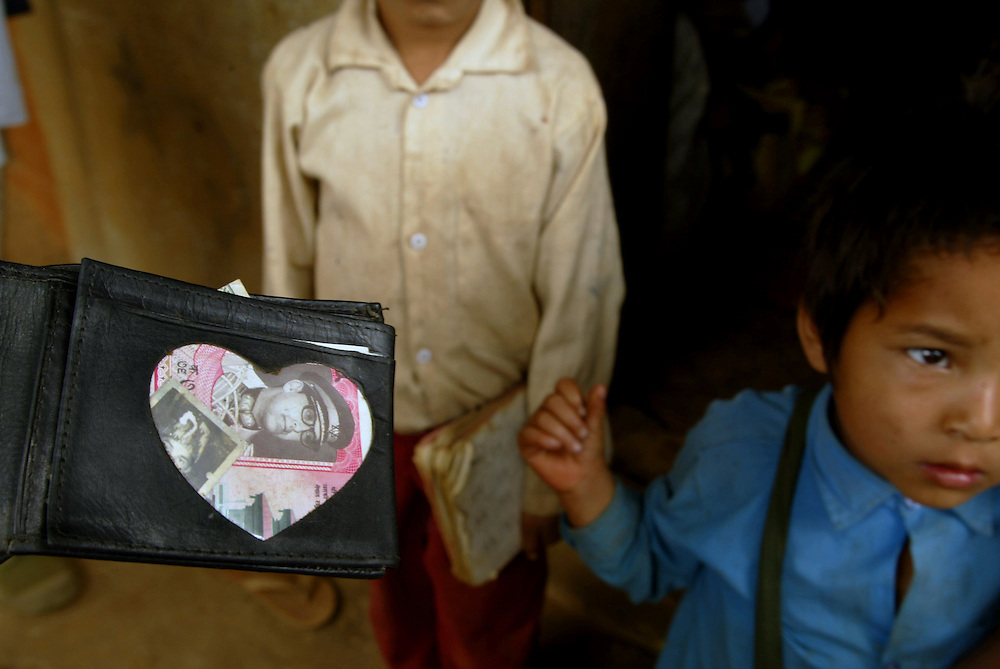A villager shows a picture of the late King Birendra of Nepal, who was murdered in alongside 10 other members of the royal family in 2001, is seen in  a heart shaped window in the wallet of a villager in the district of Rukum, viewed as the Maoist heartland Friday April 23, 2004. The Maoists, who say they are inspired by Chinese revolutionary leader Mao Zedong, have been battling since February 1996 to replace the monarchy with a communist state. The current Nepali King Gyanendra, faces besides tackling the insurgency, daily protests in the capital for dumping a democratically elected government in 2002.