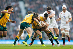 Australia Winger Rob Horne is tackled by England Outside Centre Brad Barritt - Photo mandatory by-line: Rogan Thomson/JMP - 07966 386802 - 29/11/2014 - SPORT - RUGBY UNION - London, England - Twickenham Stadium - England v Australia - QBE Autumn Internationals.