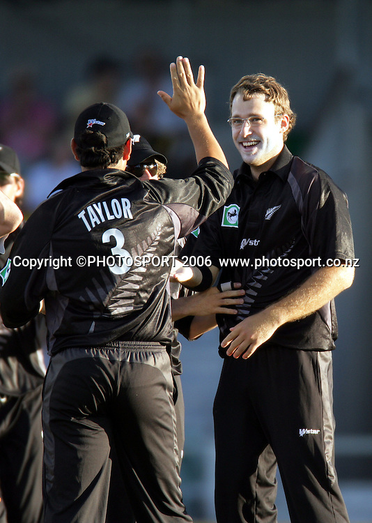 New Zealand vice captain and spin bowler Daniel Vettori is congratulated by Ross Taylor during the one day international cricket match between New Zealand and England at the WACA ground in Perth on Tuesday 30 January, 2007. New Zealand won by 58 runs. Photo: Andrew Cornaga/PHOTOSPORT<br /><br /><br /><br />300107