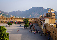 JAIPUR, INDIA - CIRCA NOVEMBER 2018: Elephants and tourists at the Amber Fort. Jaipur is the capital and the largest city of the Indian state of Rajasthan. Jaipur is also known as the Pink City, due to the dominant color scheme of its buildings and a popular tourist destination.