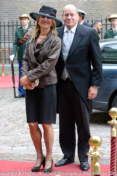 Prinsjesdag 2013 - Aankomst Parlementari&euml;rs bij de Ridderzaal op het Binnenhof.<br /> <br /> Op de foto:  Fred Teeven - Staatssecretaris van Veiligheid en Justitie en partner