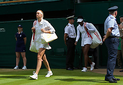 LONDON, ENGLAND - Friday, June 27, 2014: Petra Kvitova (CZE) and Venus Williams (USA) walk onto centre court before the Ladies' Singles 3rd Round match on day five of the Wimbledon Lawn Tennis Championships at the All England Lawn Tennis and Croquet Club. (Pic by David Rawcliffe/Propaganda)