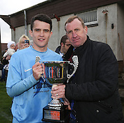 Fairfield captain Ryan Kenneth receives the Dundee Sunday FA League Cup from Dave Clunie of sponsors Dave Clunie windows and gutter cleaning services - Fairfield (light blue) v Cutty Sark (black and white) Dundee Sunday FA League Cup Final at Downfield Park<br /> <br />  - &copy; David Young - www.davidyoungphoto.co.uk - email: davidyoungphoto@gmail.com