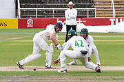 Hassan Azad & George Rhodes crowd George Balderson during the Bob Willis Trophy match between Lancashire County Cricket Club and Leicestershire County Cricket Club at Blackfinch New Road, Worcester, United Kingdom on 4 August 2020.