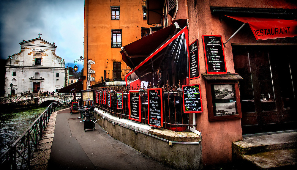 """Restaurant """"La Bastille"""" along the Thiou canal in Annecy, France in the spring of 2013."""