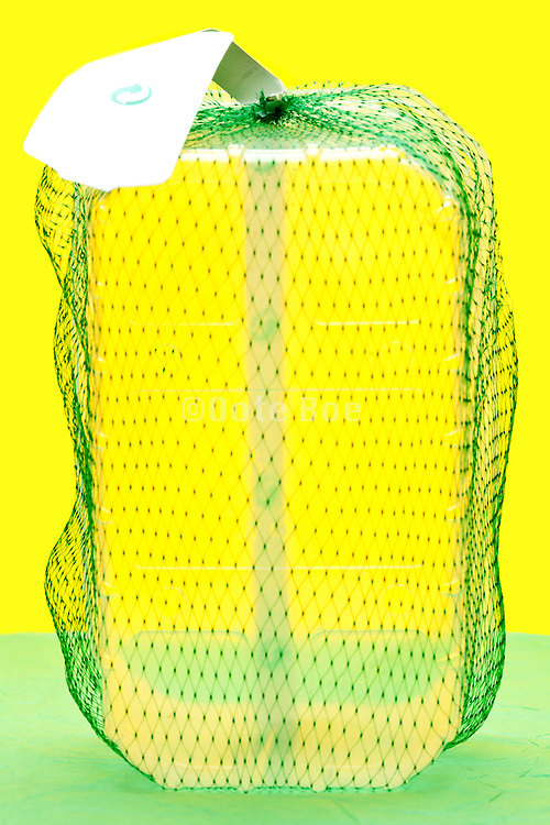 empty fruit basket with green net object on yellow green background
