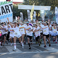 "Participants of the Color Run Orlando event start the 5K.  Billed as the ""Happiest 5K on the Planet,? the Color Run is a family-friendly run for those who don't mind getting dust thrown at them after beginning the race with a plain white t-shirt on. This is the first event of the season and occured at the Citrus Bowl in downtown Orlando, Florida on January 13, 2013. (AP Photo/Alex Menendez)"