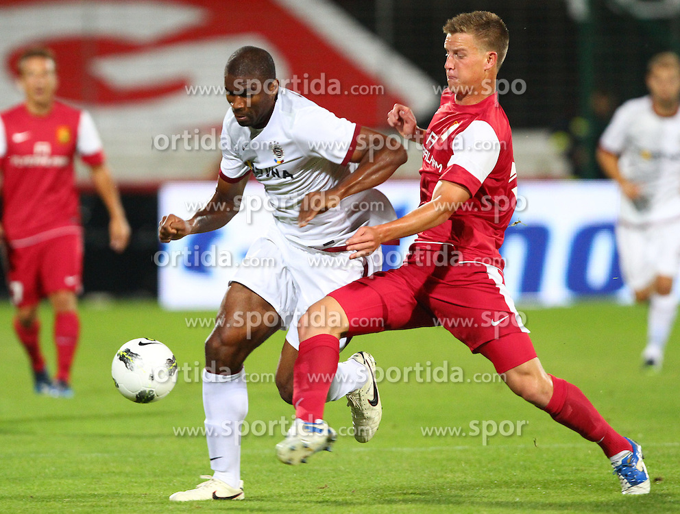 02.08.2012, Trenkwalder Arena, Maria Enzersdorf, AUT, UEFA EL, Hinspiel, FC Admira Wacker Moedling (AUT) vs AC Sparta Praha (CZE), im Bild Leony Kweuke, (AC Sparta Praha, #11) und Daniel Drescher, (FC Admira Wacker Moedling, #5) // during UEFA Europa League 1st Leg Match between FC Admira Wacker Moedling (AUT) vs AC Sparta Praha (CZE) at the Trenkwalder Arena, Maria Enzersdorf, Austria on 2012/08/02. EXPA Pictures © 2012, PhotoCredit: EXPA/ Thomas Haumer
