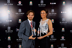 CARDIFF, WALES - Monday, October 2, 2017: Orchard Welsh Premier Women's League Club Woman of the Year award winner Alicia Powe [R] and FAW Fans' Player of the Year Joe Allen [L] during the FAW Awards Dinner at the Hensol Castle. (Pic by David Rawcliffe/Propaganda)
