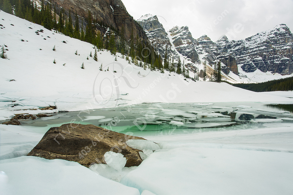 An early spring visit to Moraine Lake in Banff National Park. The lake was still mostly frozen over and ther was plenty of snow on the ground.<br /> <br /> &copy;2014, Sean Phillips<br /> http://www.RiverwoodPhotography.com