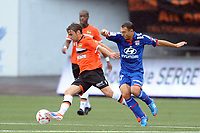 FOOTBALL - FRENCH CHAMPIONSHIP 2012/2013 - L1 - FC LORIENT v OLYMPIQUE LYONNAIS  - 7/10/2012 - PHOTO PASCAL ALLEE / DPPI - YANN JOUFFRE (FCL) / STEED MALBRANQUE (OL)