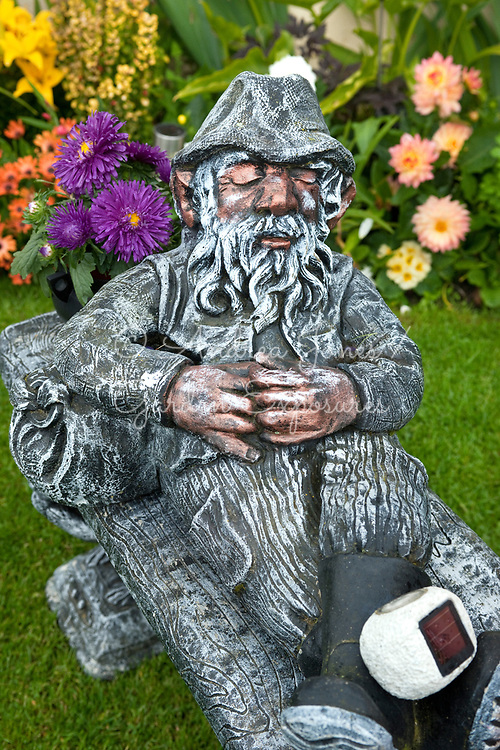 Reclining man ornament in Cornelius and Una Mockler's garden
