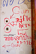 Apr. 14 - Bangkok, Thailand: Red Shirt supporters have marked what they claim are bullet holes left by government rifles in a wall on Khao San Road in Bangkok. Khao San Road is better known as Bangkok's backpacker row. The Red Shirts moved their main protest its original location in the old part of Bangkok to the Ratchaprasong intersection, in the center of Bangkok's shopping malls and five star hotels. Many signs of last weekend's violence is still on display around their original encampment though. Photo by Jack Kurtz