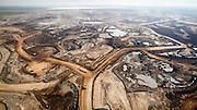 Excavation of oil sand at one of the oil sand mines in Fort McMurray in Alberta, Canada. The Athabasca oil sands deposit is among the largest in the world.  The bitumen, also commonly named tar (hence tar sands), contains lots of hydrocarbons, but is notoriously hard to extract. For every 100 BTU of energy extracted, 70 BTU is lost in the process. In 2011 alone, the oil sands operations in Canada produced 55 million tons of 'greenhouse gas emissions'. That's eight percent of Canada's total emissions.