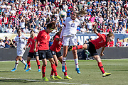USA midfielder Ali Long (20) heads a shot versus Korea Republic defenders Lim Seonjoo (6), Cho So Hyun (8), and Lee Youngju (7) during an international friendly soccer game in Chicago, Sunday, Oct. 6, 2019, in Chicago. The team splayed to a 1-1 tie. (Max Siker/Image of Sport)