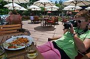 Hat Chaweng (beach). Central Samui Beach Resort. A bird stealing noodles from Nicole Schmidt's plate.