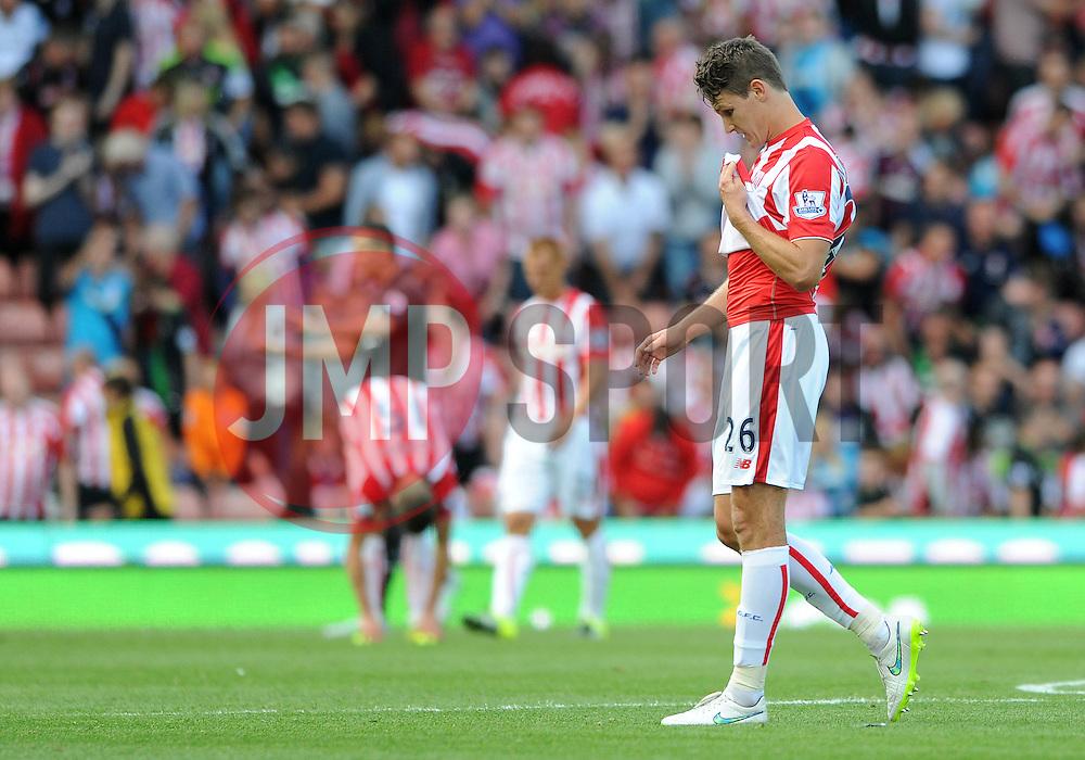 Philipp Wollscheid of Stoke City cuts a dejected figure - Mandatory byline: Dougie Allward/JMP - 07966386802 - 09/08/2015 - FOOTBALL - Britannia Stadium -Stoke-On-Trent,England - Stoke City v Liverpool - Barclays Premier League