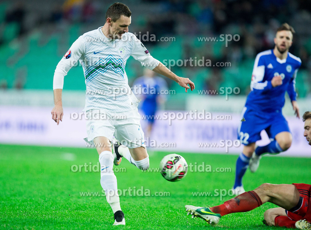 Milivoje Novakovic of Slovenia vs Elia Benedettini of San Marino during football match between NationalTeams of Slovenia and San Marino in Round 5 of EURO 2016 Qualifications, on March 27, 2015 in SRC Stozice, Ljubljana, Slovenia. Photo by Vid Ponikvar / Sportida