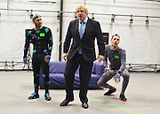 "© Licensed to London News Pictures. 04/04/2013. London, UK (Left to right) Actors Matt Cross, Boris Johnson, Dawson James. Boris Johnson the Mayor of London, visits Ealing studios today, 4th April 2013, where he announced his plans to boost London's TV, Animation and Film industries, capitalising on the new tax relief brought in by the Chancellor (from 1st April 2013) to bring major jobs and investment to the capital. He toured the Studios and spent time in the ""Imaginarium"", where he had a go at mastering 'performance capture'. . Photo credit : Stephen Simpson/LNP"