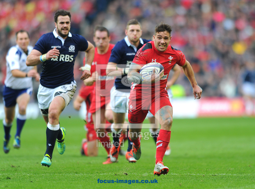 Rhys Webb of Wales (right) runs with the ball during the RBS 6 Nations match at Murrayfield Stadium, Edinburgh<br /> Picture by Greg Kwasnik/Focus Images Ltd +44 7902 021456<br /> 15/02/2015