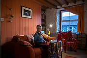 Sian, A Bethesda Resident and Energy Local member at home in her cottage using energy. <br /> Energy Local, Bethesda, North Wales.