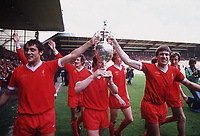 Fotball<br /> England <br /> Foto: Colorsport/Digitalsport<br /> NORWAY ONLY<br /> <br /> Ray Kennedy, Jimmy Case (Obscured) and Emlyn Hughes celebrate with the League Championship trophy. Liverpool. Football 1976/7