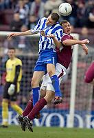 Fotball<br /> Skottland 2004/2005<br /> Foto: SBI/Digitalsport<br /> NORWAY ONLY<br /> <br /> Hearts v Kilmarnock, Scottish Cup fourth round, Tynecastle Park, Edinburgh. 05/02/2005<br /> <br /> Andy Webster gets better of Colin Nish
