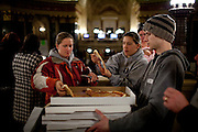 Paul Sarnwick of Ian's Pizza distributes pizzas donated to protestors at the State Capitol in Madison, WI, February 23, 2011.