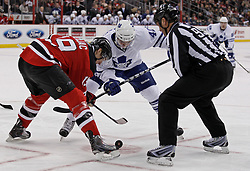 Jan 29, 2010; Newark, NJ, USA; New Jersey Devils center Travis Zajac (19) and Toronto Maple Leafs center Tyler Bozak (42) faceoff during the first period at the Prudential Center.