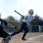 Goldey-Beacom pitcher Roni Peters (6) makes contact with the ball in the fifth inning of a NCAA Central Atlantic Collegiate Conference game against Post University Saturday, March 30, 2013, at Nancy Churchmann Sawin Athletic Field in Wilmington Delaware.