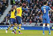 Arsenal's Mesut Özil celebrates his goal with \Arsenal's Theo Walcott during the The FA Cup match between Brighton and Hove Albion and Arsenal at the American Express Community Stadium, Brighton and Hove, England on 25 January 2015. Photo by Phil Duncan.