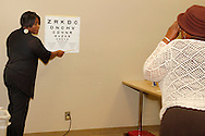 Christie Haney of Miamisburg (left) administers a vision screening during the 10th Annual Celebrating life & health free community health fair at Sinclair's Ponitz Center in downtown Dayton, Saturday, April 21, 2012. More than 50 vendors were spread over three floors providing vision, hearing, blood pressure and other screenings, health information and entertainment.