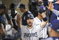 May 2, 2017 - San Diego, CA, USA - The San Diego Padres' Ryan Schimpf celebrates in the dugout with teammates after he hit a solo home run in the sixth inning against the Colorado Rockies at Petco Park in San Diego on Tuesday, May 2, 2017. (Credit Image: © Hayne Palmour Iv/TNS via ZUMA Wire)