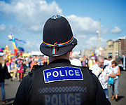 Brighton Pride 2017 <br /> Brighton Seafront and through the town towards Preston Park. <br /> East Sussex, Great Britain <br /> 5th August 2017 <br /> <br /> Brighton Pride <br /> A police officer wears a rainbow ribbon around his helmet <br /> <br /> Photograph by Elliott Franks <br /> Image licensed to Elliott Franks Photography Services