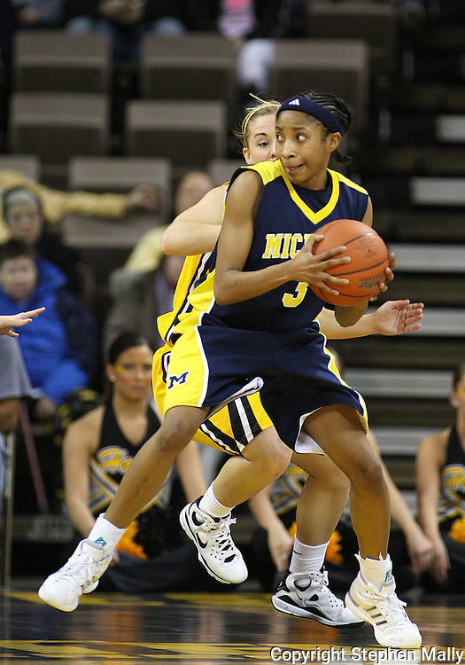26 JANUARY 2009: Michigan guard Veronica Hicks (3) is guarded by Iowa guard Kamille Wahlin (2) during the first half of an NCAA women's college basketball game Monday, Jan. 26, 2009, at Carver-Hawkeye Arena in Iowa City, Iowa. Iowa defeated Michigan 77-69.
