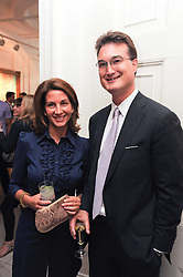 LORD ROBIN RUSSELL and his wife STEPHANIE at a party to celebrate the launch of Page One an online guide to London's 100 most rewarding restaurants held at the Halcyon Gallery, Bruton Street, London on 7th July 2010.